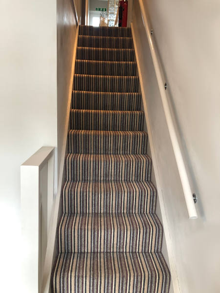 Stairs at Innovation Wigs and Hair Loss